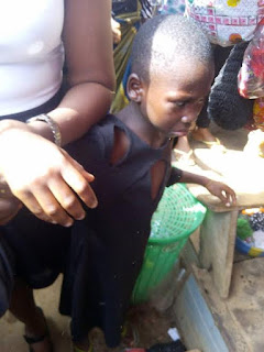 Photos: Woman nearly lynched in Onitsha for physically abusing her housemaid in public