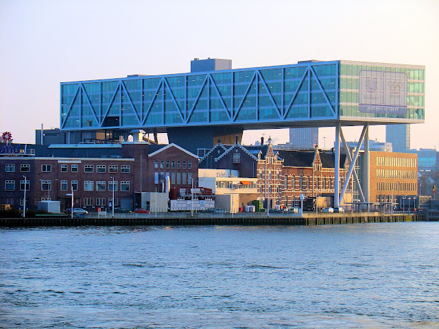Modern meets traditional Dutch architecture in Rotterdam, The Netherlands. Unilever wasn't permitted to tear down the traditional Dutch architecture so they built up and over it.