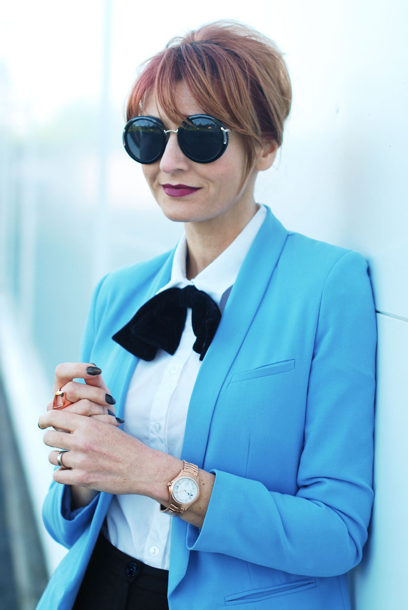 A Luxury Swiss Watch Styled With a Le Corbusier Influence: Blue Blazer and Bow Tie