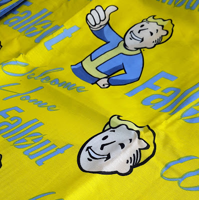 Falloit vault boy fabric in yellow and blue with repeated design
