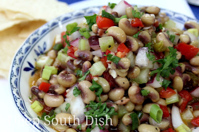 Southern Caviar - a vinaigrette dressed, festive southern vegetable salad twist on salsa, made with black-eyed peas, celery, pimentos, jalapeno, garlic, green onion and fresh tomato, and beloved on the church supper, potluck and entertaining circuits.