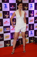 Actress Gauhar Khan  Pictures in White Shorts at Mirchi Music Awards 2016  0005.jpg