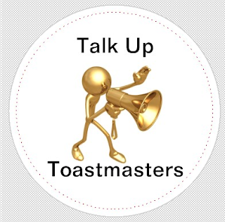 "Image is of a three-dimensional stick figure style cartoon holding a megaphone. The text says, ""talk up Toastmasters"""