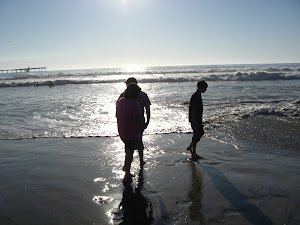 Daniel,Michael and Ariel wading in the ocean.
