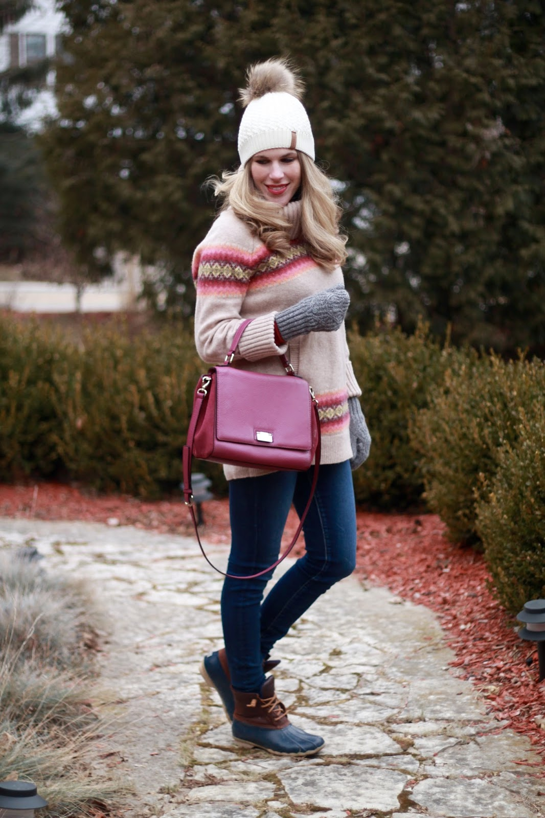 fair isle tunic sweater, AEO skinny jeans, Sperry duck boots, berry plum Kate Spade crossbody bag, white fur pom pom beanie
