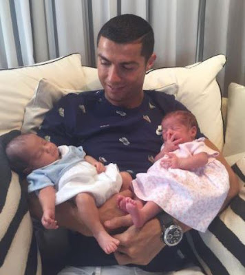 Cristiano Ronaldo poses for first snap holding newborn baby girl