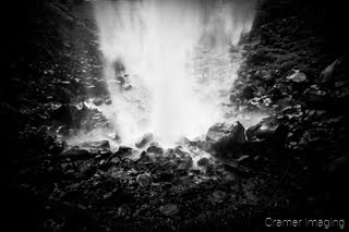 Cramer Imaging's black and white or monochromatic fine art landscape photograph of the backside of a waterfall in Twin Falls Idaho