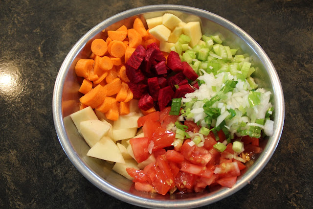 bowl of chopped vegetables for beet and cabbage borscht