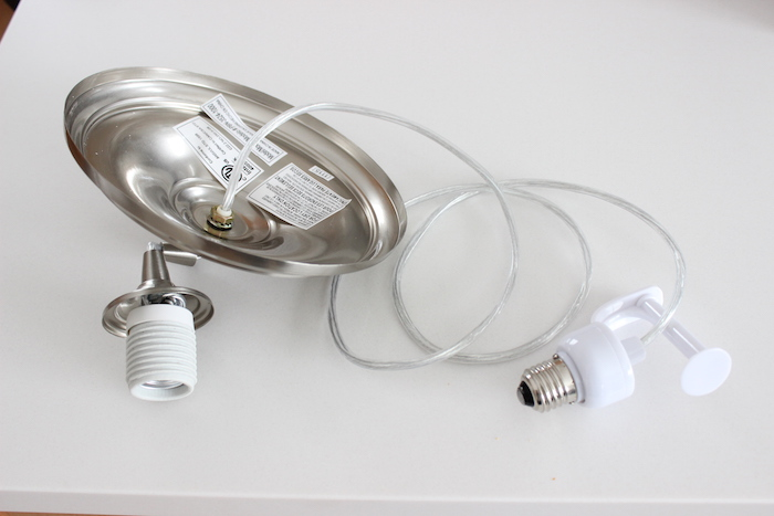... screws into the light socket in the ceiling (where you just removed the  canned light bulb from), and the left part will be the end where the pendant  ... - It's A Grandville Life : Pendant Light Conversion Kit Kitchen Makeover
