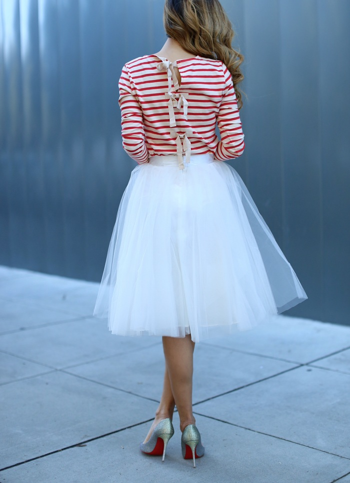 J crew STRIPED TSHIRT WITH BOW-EMBELLISHED BACK, tutu skirt, christian louboutin glitter pumps, chanel brooch, chanel bag, New years eve look, holiday party look, date night, romantic look, holiday outfit ideas
