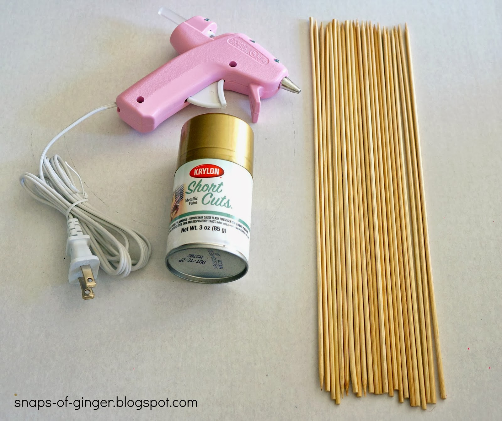 Wooden skewers hot glue gun krylon gold spray paint