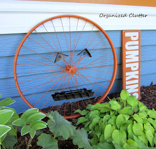 Repurposed Bicycle Wheel Jack o'Lantern www.organizedclutterqueen.blogspot.com