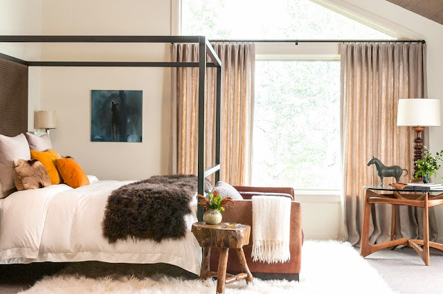 Modern rustic bedroom with fur blanket and flokati rug