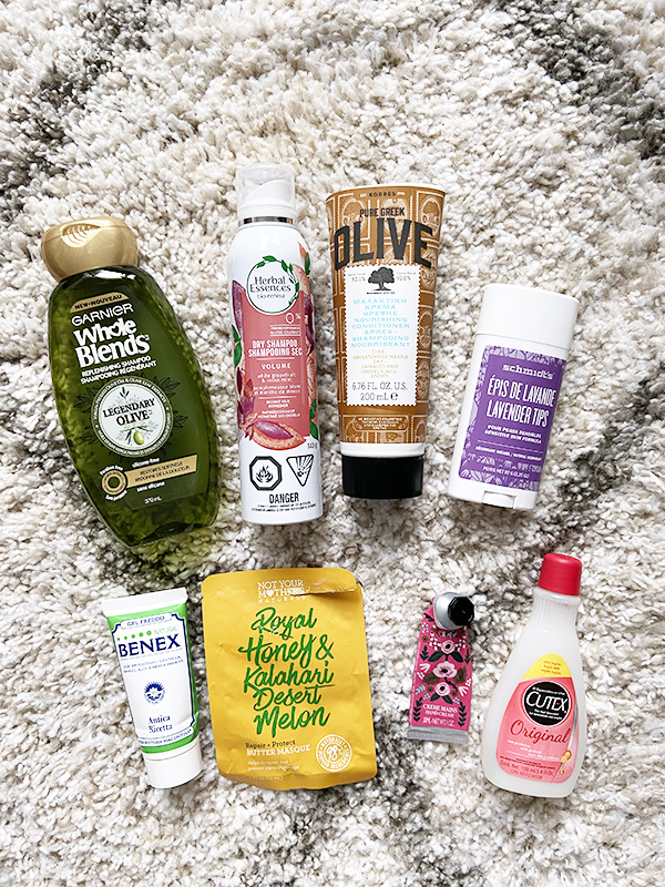 Empty hair and body care products from Garnier, Herbal Essences, Korres, Schmidt's, Gel Freddo Natural Benex, Not Your Mother's Naturals, L'Occitane, and Cutex