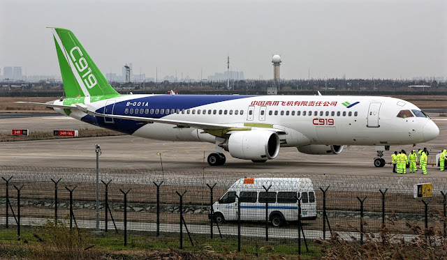 comac c919 is being towed