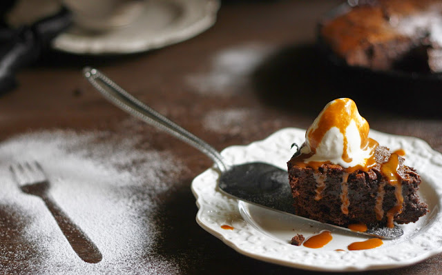 Perfect gooey brownies made in a skilltet with salted caramel sauce and Lindt chocolate swirled right into it