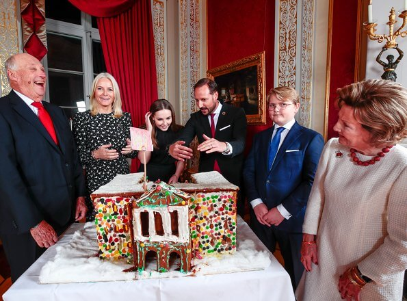 Princess Ingrid Alexandra, Sverre Magnus and Queen Sonja. Crown Princess Mette-Marit wore a white dove bird-print dress