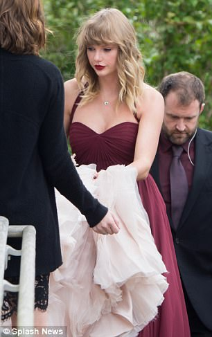 Taylor Swift is booed by fans who waited in rain to see her in bridesmaid's outfit after best friend's wedding