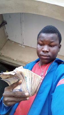 Photos: Lol... young Nigerian hustler shows off his money and drinks