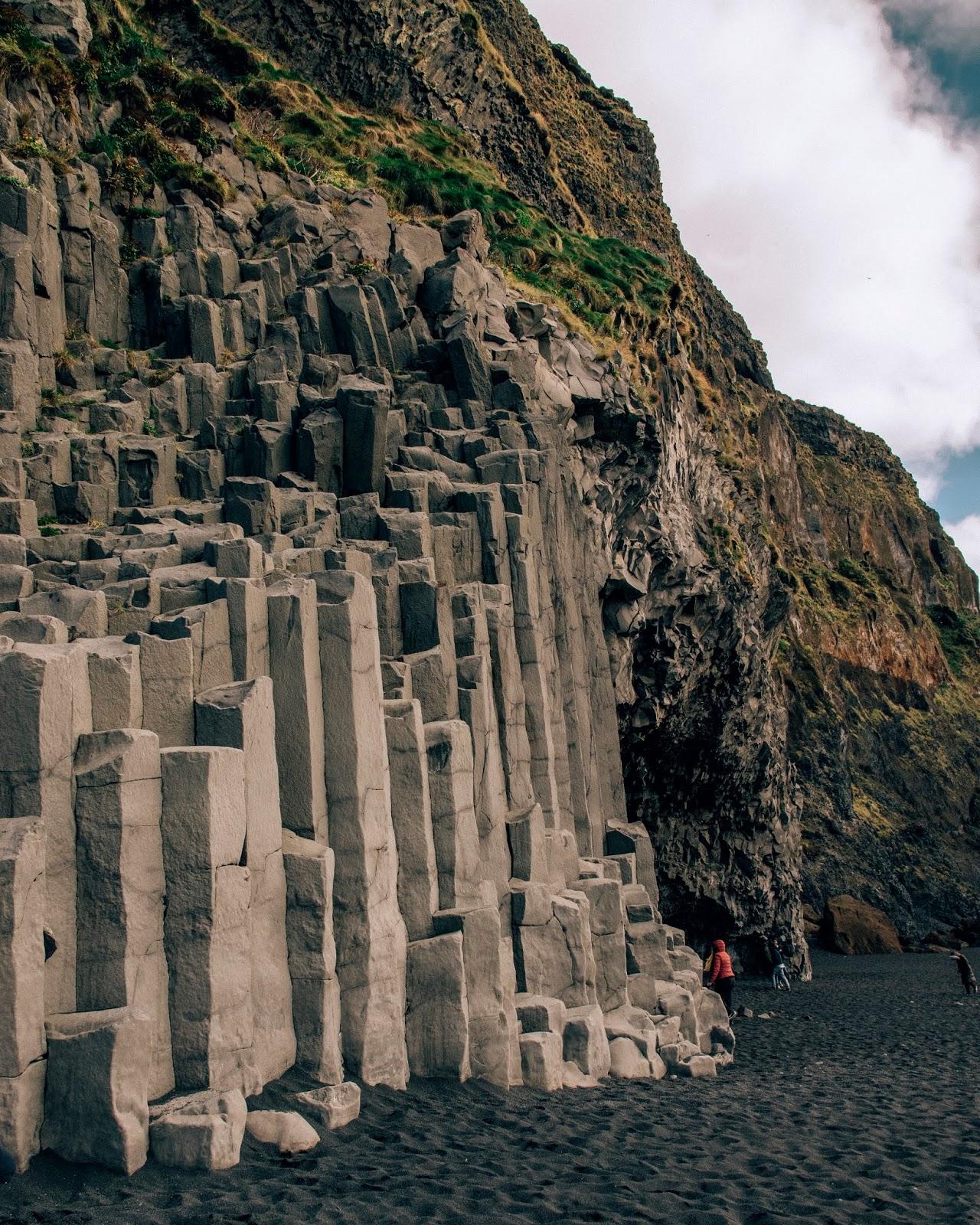 Basalt columns on black sand beach in Iceland