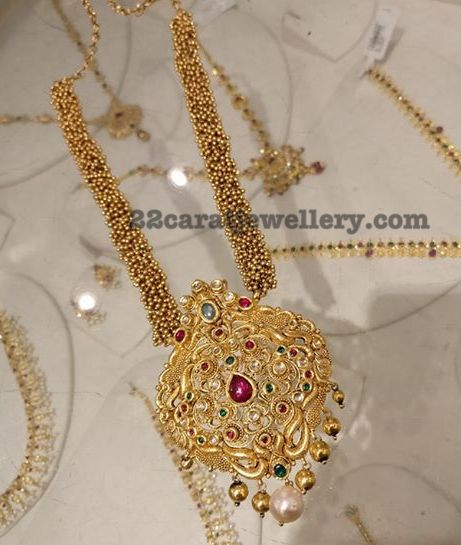 Trendy Muvvala Haram with Kundan Locket