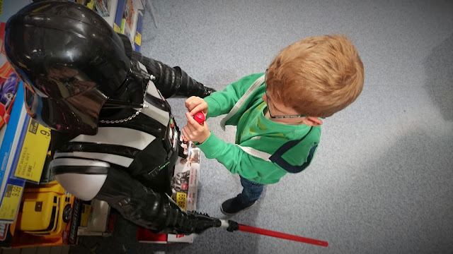 Dylan showing large Darth Vader holding light sabor an owlette toy inside a toy shop.  Project 365 Day 197 on the 16th July 2018 from Us Two Plus You