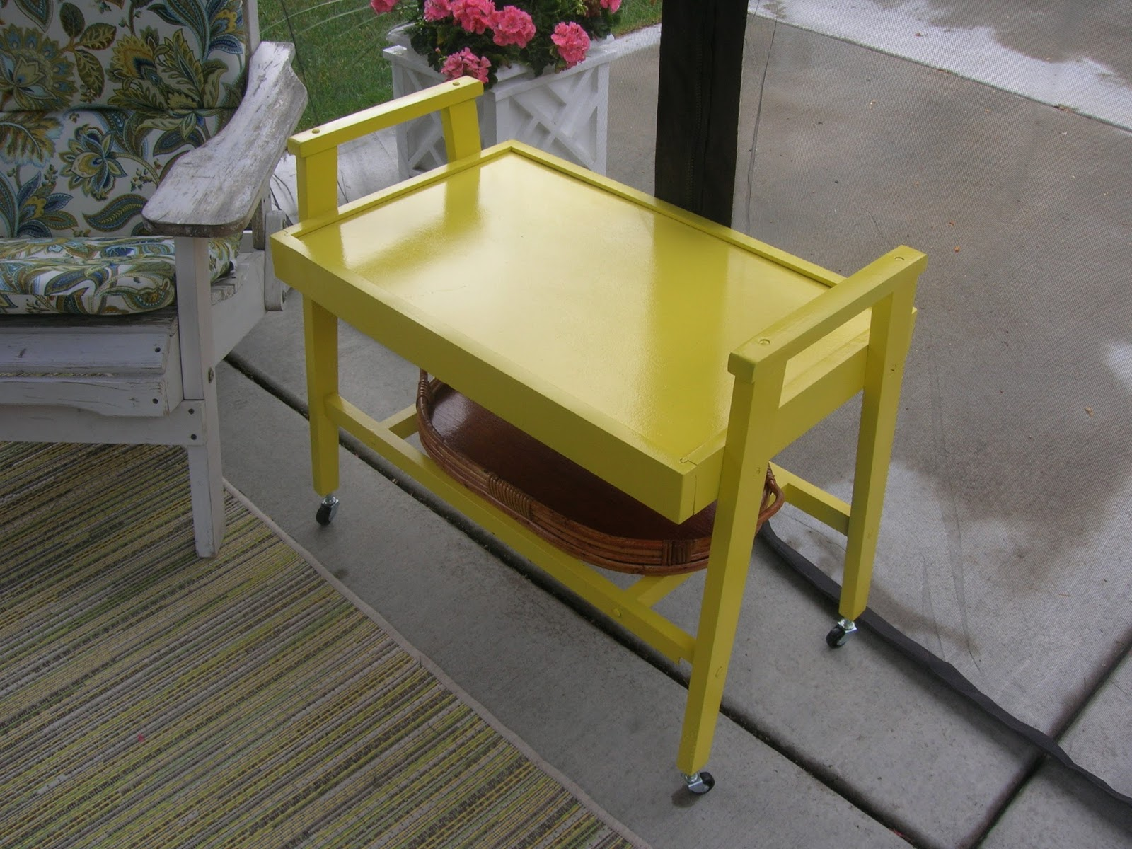 Maison newton yellow outdoor coffee tableside table done three plus coats 2 cans yellow spray paint over 2 coats of primer to give me the glossy look i wanted sheds water really well tested out last night geotapseo Choice Image