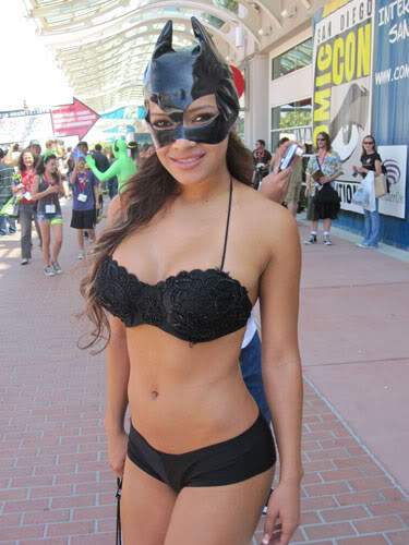 Woman in black bikini with cat woman mask