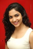Actress Ritu Varma Stills in White Floral Short Dress at Kesava Movie Success Meet .COM 0218.JPG