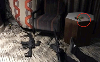Vegas shooter's body is seen splayed on the floor of his hotel room next to his arsenal of assault rifles and ammunition in crime scene photos - as it's revealed he hid a camera in a room service cart so he knew when SWAT teams prepared to enter