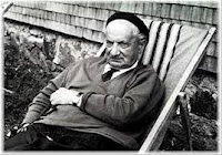 "Heidegger with cap, sunning outside his ""lie of a log cabin"""