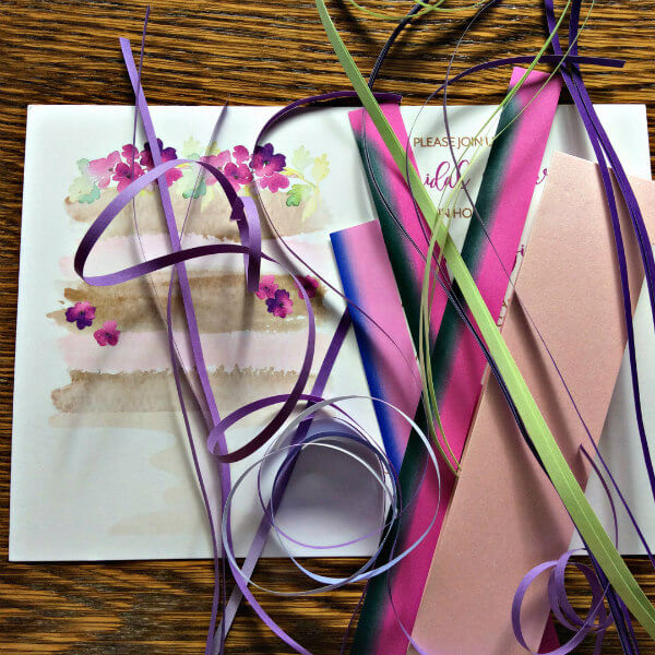 bridal shower invitation and jumble of quilling strips