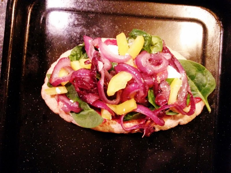 Pitta bread pizza with caramelised onion and goats cheese