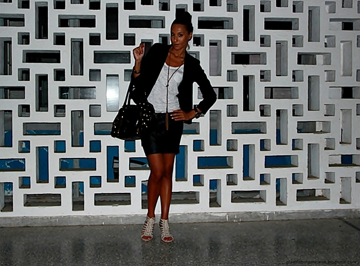 black blazer, black mini skirt, white tee, lace-up beige sandals, black purse