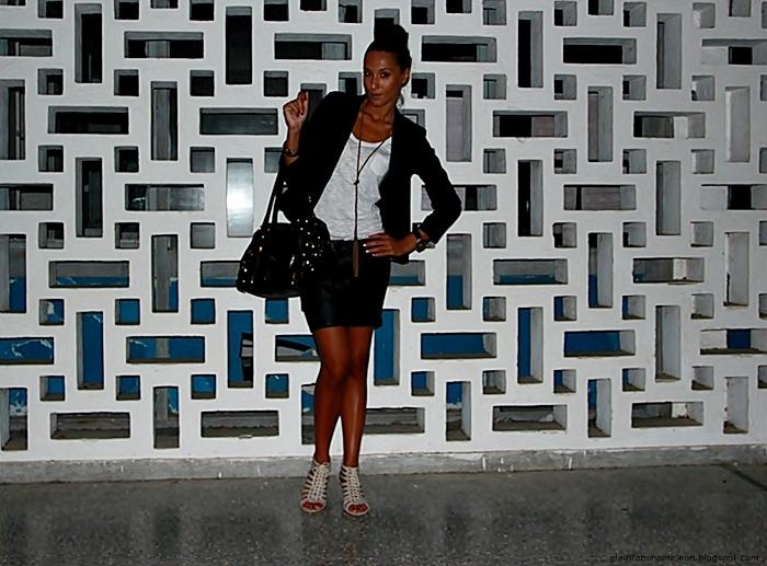 black blazer, black mini skirt, white tee, lace-up beige sandals, black purse