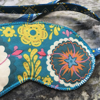 eye mask, close up of embroidery and machine blanket stitch with 12wt thread