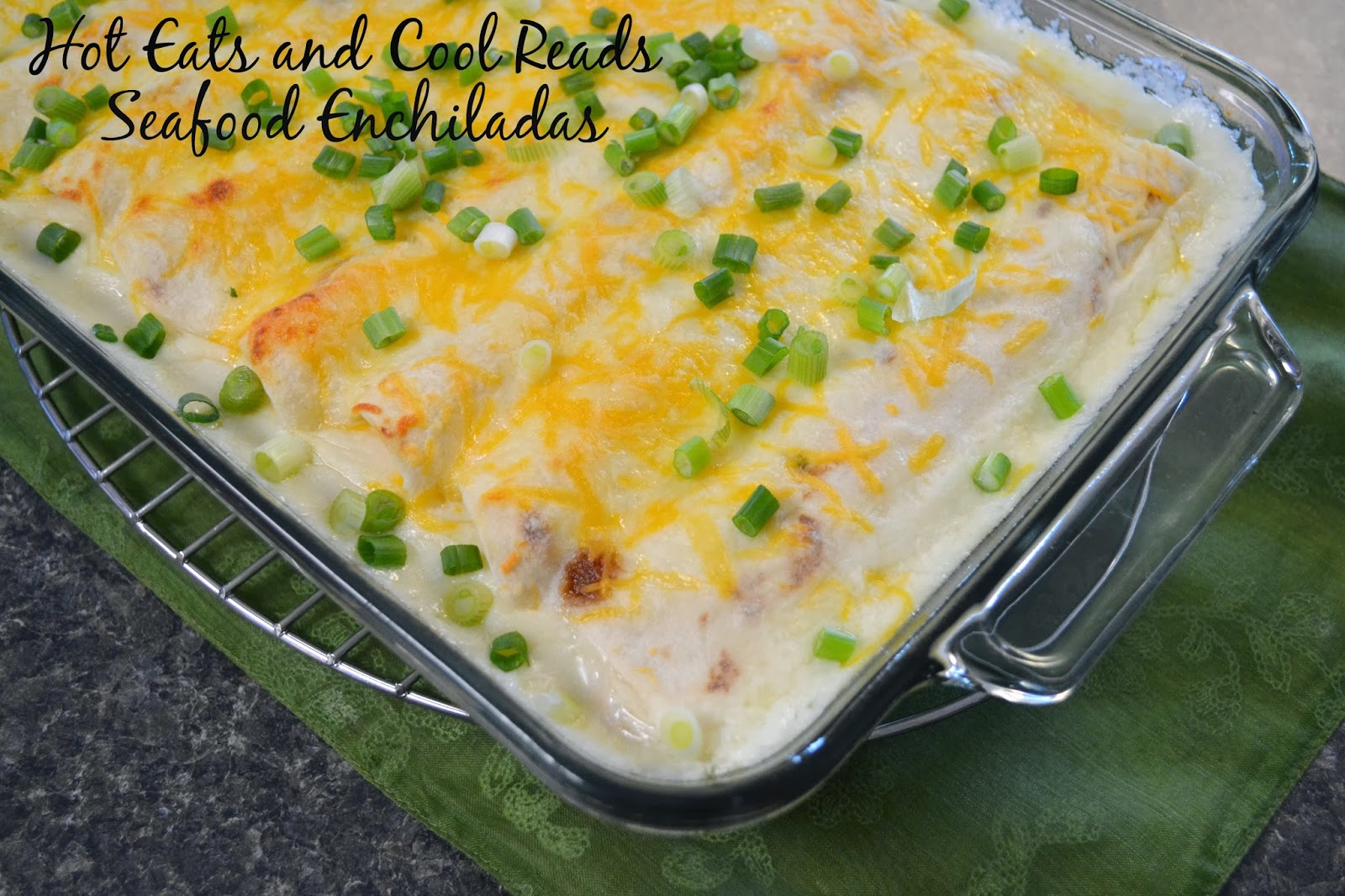 Make your Mexican restaurant favorite at home! So delicious and budget friendly compared to eating out! Shrimp and Crab Seafood Enchiladas Recipe from Hot Eats and Cool Reads!