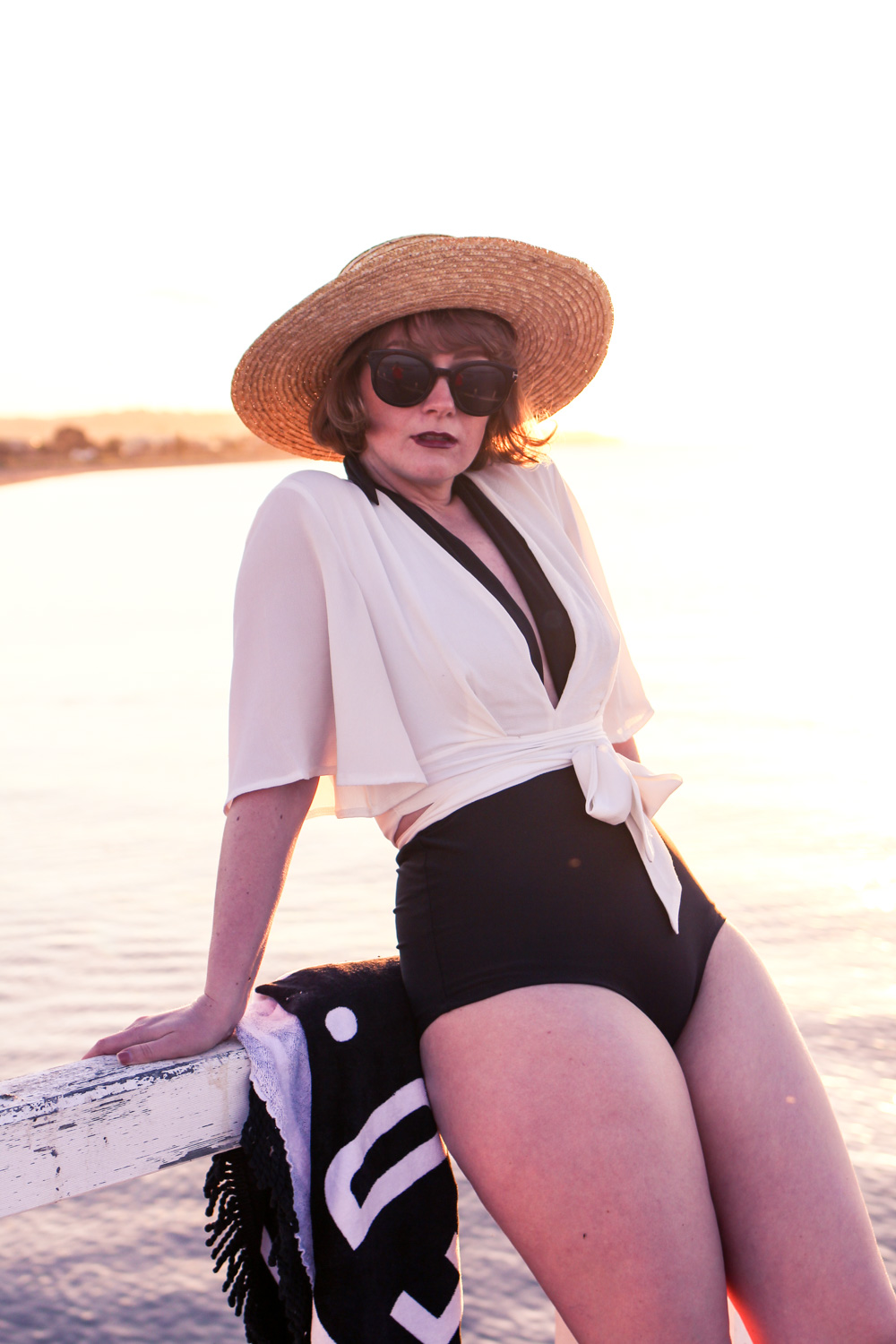 @findingfemme wears black and white bikiniboo swimwear at the beach
