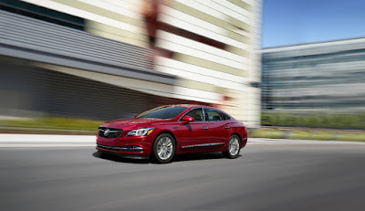 A red 2019 Buick LaCrosse ST speeds past an office complex.