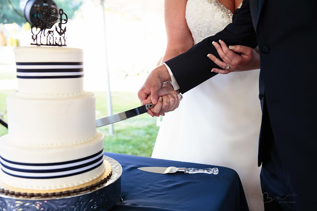 cake cutting at new baltimore waterfront wedding
