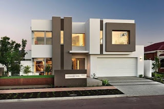 Modern house facades with glass windows and garden edging