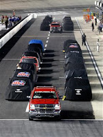 Trucks parked on pit road due to weather. #NASCAR