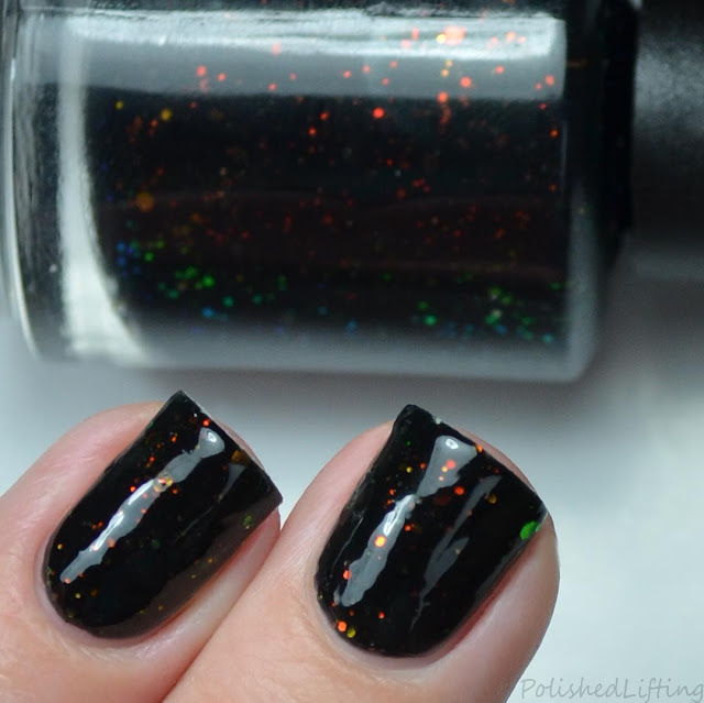 navy blue nail polish with color shifting glitter