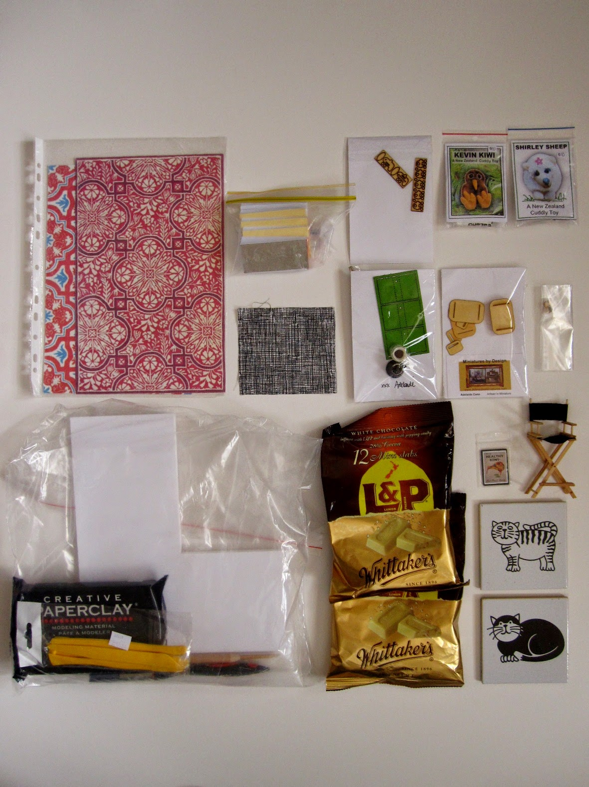 A selection of miniature items and bags of chocolate arranged neatly on a surface