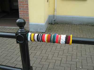 Yarnbombing tag on railing