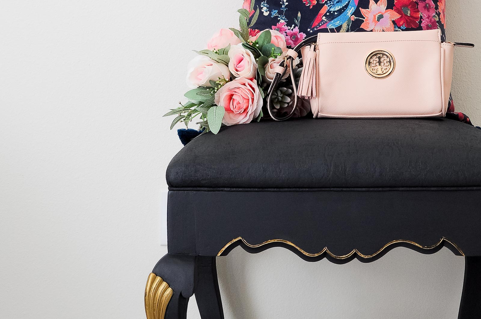 A thrift store ottoman gets a DIY black and gold makeover (even the fabric!) using Velvet Finishes paint.