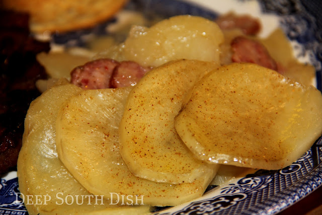 Seasoned potatoes, layered with onion and smoked sausage and slow simmered on the stovetop. Top layer of potatoes pictured.