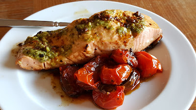 Pan-seared wild salmon with pesto and blistered cherry tomatoes