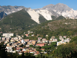 The mountains around Carrara sometimes appear to be covered in snow even in summer