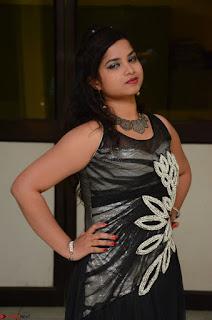Shrisha Dasari in Sleeveless Short Black Dress At Follow Follow U Audio Launch 008.JPG